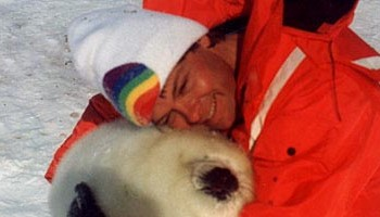 Michael hugs a harp seal pup during efforts to stop the annual slaughter.